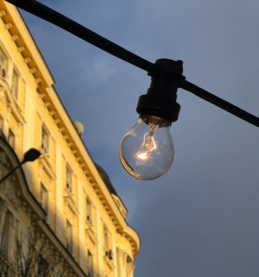 photo of a single lightbulb in the city